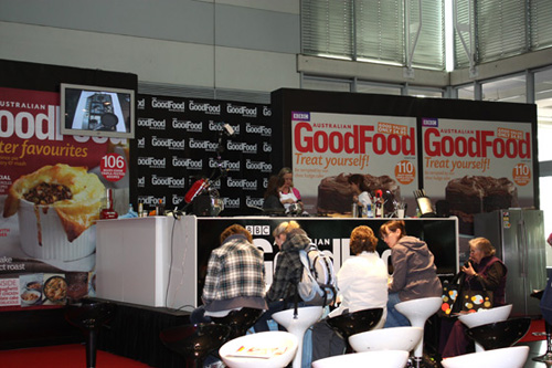 Getting ready for cooking demonstrations at BBC Australian Good Food's Stage.